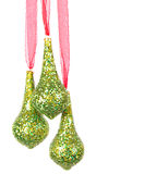 Three hanging Christmas or holiday ornaments Royalty Free Stock Photos