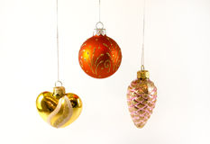 Three hanging Christmas tree toys. Heart shaped, Christmas ball and cone shaped. Isolated on white background Royalty Free Stock Photography