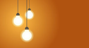 Three hanging light bulbs glowing on yellow background with copy space. Three hanging light bulbs glowing on a yellow background. Place for your text. Vector Royalty Free Stock Images