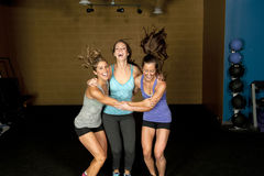 Three Happy Athletic Females Stock Images