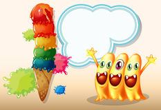 Three happy beanie monsters near the giant icecream Royalty Free Stock Photography