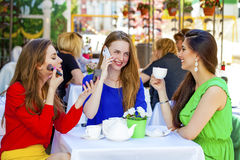 Three happy beautiful girls girlfriend drinking tea in a summer Royalty Free Stock Photos