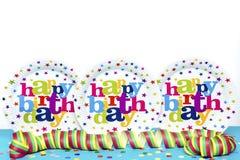 Three Happy Birthday plates. And confetti stock photo
