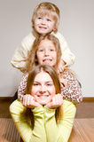 Three happy brother and sisters hug Royalty Free Stock Images