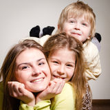 Three happy brother and sisters hug Stock Images