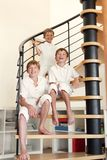 Three happy brother sitting on steps. Stock Photography
