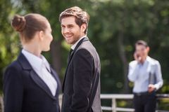 Three happy business partner people talking outside. Stock Images