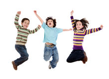 Three happy children jumping at once stock photography