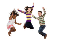 Three happy children jumping at once