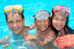 Three happy children in pool Stock Photography
