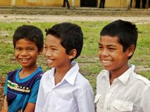 Three happy children. Portrait of three happy Cambodian children at school Royalty Free Stock Images