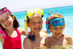 Three happy children in water Stock Photo
