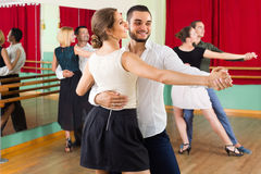 Three happy couples dancing tango Stock Photo