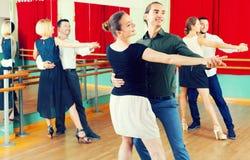 Three happy couples dancing tango Royalty Free Stock Photos