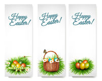Three Happy Easter banners with easter eggs in a basket. And grren grass. Vector Royalty Free Stock Photo