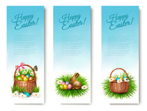 Three Happy Easter banners with Easter eggs in a basket. Vector Royalty Free Stock Image