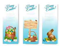 Three Happy Easter banners with Easter eggs in a basket. Royalty Free Stock Photo