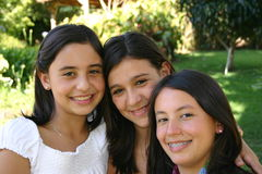 Three happy faces. Three female teenagres Royalty Free Stock Photography