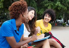 Three happy female students learning outdoor. In a park outdoor in the summer Royalty Free Stock Photos