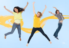 Three happy friends jumping for joy Royalty Free Stock Images