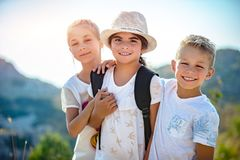Three happy friends. Portrait of a three happy friends outdoors, siblings with pleasure traveling together, having fun in summer camp, best friends forever royalty free stock image