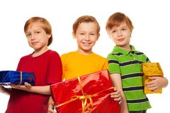 Three happy friends with presents Stock Images