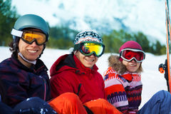 Three happy friends in ski masks laughing Royalty Free Stock Photo