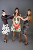 Three happy girls. Holding red heart Royalty Free Stock Photo