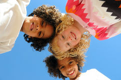 Three Happy Girls. A view of three happy kids looking down at the camera Stock Photo