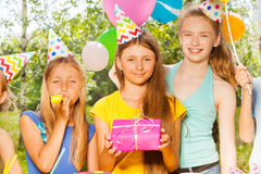 Three happy girls celebrating Birthday outdoors Royalty Free Stock Photos