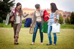 Three happy girls doing shopping Royalty Free Stock Photography
