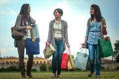Three happy girls doing shopping Royalty Free Stock Photos