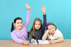 Three happy girls doing their school work Stock Photo