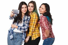 Three happy girls models make selfie. smiling. isolated on white background stock photos