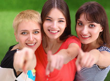 Three happy girls pointing fingers at you choosing Royalty Free Stock Photography