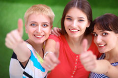 Three happy girls pointing fingers at you choosing Royalty Free Stock Photo