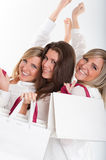 Three happy girls with shopping bags Royalty Free Stock Photography