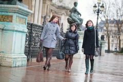 Three happy girls walking together Royalty Free Stock Image