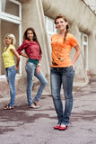 Three happy girls wearing jeans Royalty Free Stock Photo