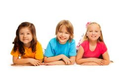 Three kids on the floor in line Stock Image
