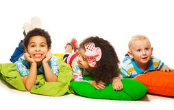 Three happy kids on the pillows Royalty Free Stock Photo