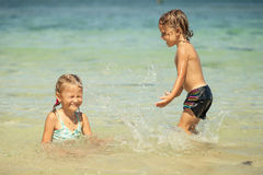 Three happy kids playing on beach Royalty Free Stock Images