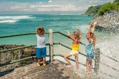 Three happy kids playing on beach Royalty Free Stock Photos