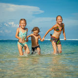 Three happy kids playing on beach Royalty Free Stock Photos