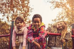 Three little girls looking at camera. stock image