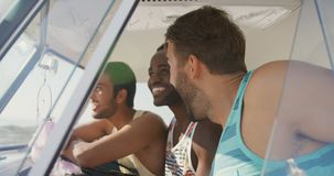 Three happy male adult friends sitting in the front of a camper van 4k stock video