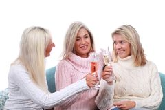 Three happy mature woman with sparkling wine Royalty Free Stock Image
