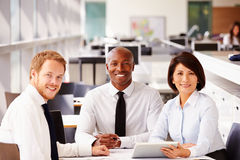Three happy office colleagues looking to camera royalty free stock images
