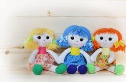 Three happy rag dolls stock photos