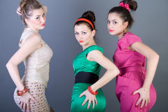 Three happy retro-styled girls Stock Photography